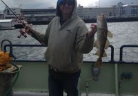 Crew member Leo Fitz catches a cod right off the ship in Reykjavik harbor!