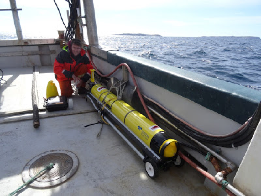 Mark Downey getting the glider ready for deployment with the Gannett Islands in the background.