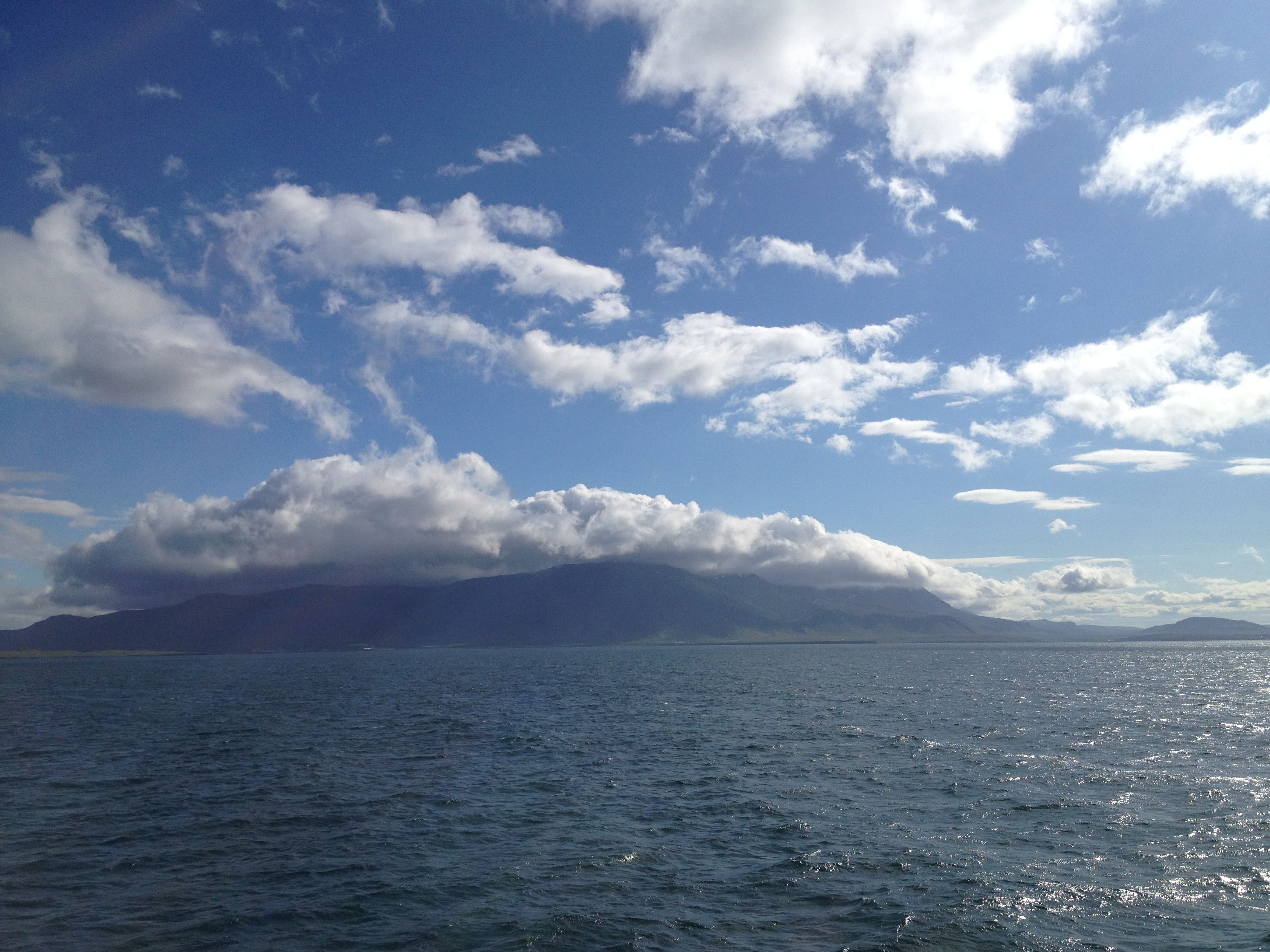 Clouds over the mountains leaving Reykjavik harbor