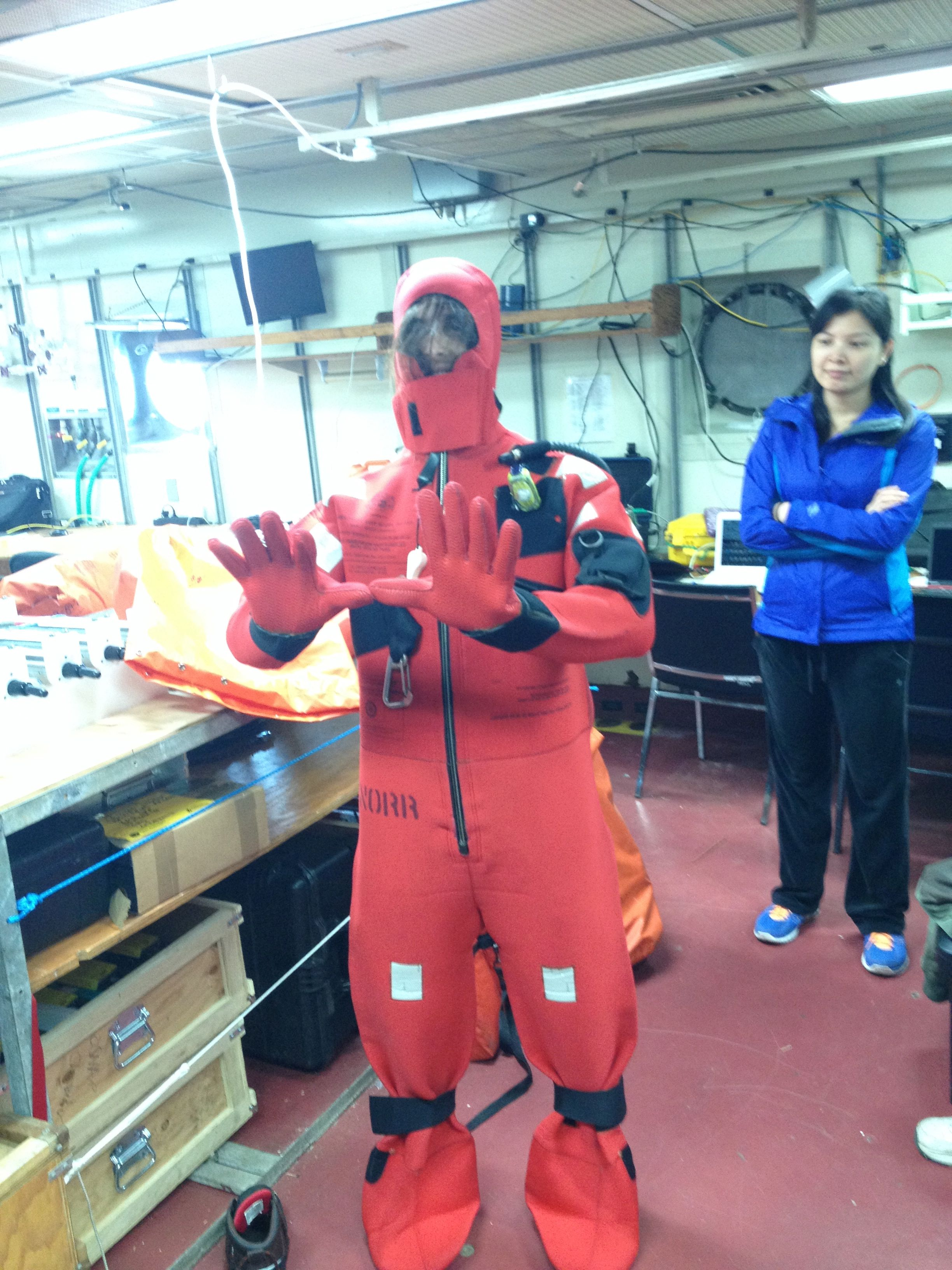 University of Miami technician Robert Salom tries on his survival suit in a pre-cruise safety drill